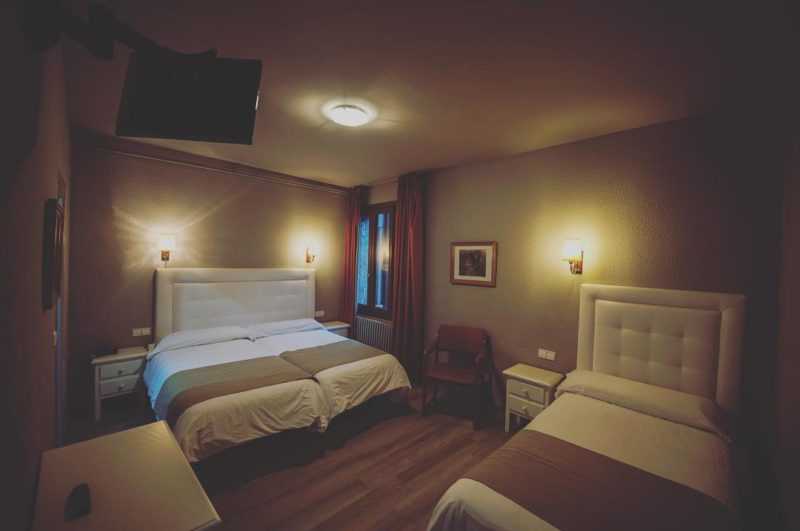 Habitacion con tres camas